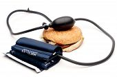 Blood Pressure Cuff And Hamburger On White - Health
