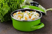 garnish rice with various vegetables (carrots, corn and green peas)