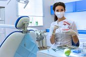 Dentist In Mask Holding Green Apple.