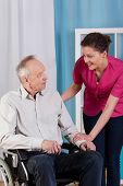 Disabled Man On Wheelchair And Nurse