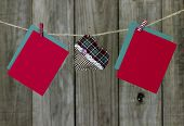Blank Christmas cards and country fabric heart hanging on clothesline