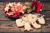 stock photo of christmas cookie  - Christmas cookies handmade lies on wooden background - JPG