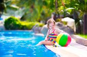 Little Cute Girl In A Swimming Pool