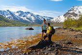 Sportsman And Woman Near Mountain Lake