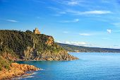 Cliff Rock And Building On The Sea On Sunset. Quercianella, Tuscany Riviera, Italy