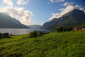 Beautiful landscape with a farm land in the norwegian mountains next to a lake