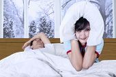 Woman And Snoring Man On Bed