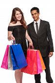 Couple With Colorful Shopping Bags.