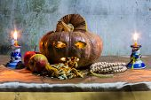 Halloween Still Life With Pumpkins, Apple, Candles And Rosary