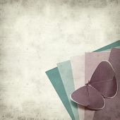 picture of kirigami  - textured old paper background with kirigami butterfly - JPG