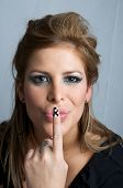 attractive blonde woman making a gesture of silence with his finger