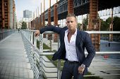 Handsome Muscular Blond Man Standing In City Environment