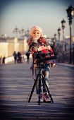 pic of beret  - Girl in a pink beret stand near the camera on a support blue toning and vignetting - JPG
