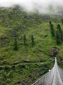Suspension Bridge In Green Himalayas During Monsoon