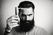 B/w Portrait Of Brutal Man With Straight Razor