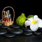 Aromatic Spa Setting Of Bergamot Fruits, Candles, Plumeria Flower And Bottles Essential Oil On Zen S