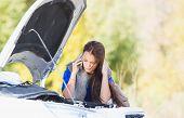 woman with a broken car
