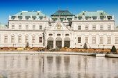 picture of winter palace  - Full view of a baroque Upper Palace and historical complex Belvedere Vienna Austria in winter with iced pond - JPG