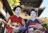 Geisha Women In Traditional Dress