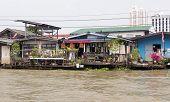 Dwellings of poor people on the embankment to Bangkok, Thailand