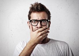 image of shot glasses  - Portrait of a surprised young man wearing eyeglasses - JPG