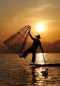 foto of fishermen  - Traditional fisherman at Inle Lake during the sunset - JPG