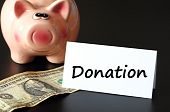pic of non-profit  - donation or donate concept with piggy bank on black background - JPG