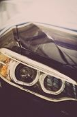 stock photo of headlight  - Detail on one of the LED headlights of a car - JPG