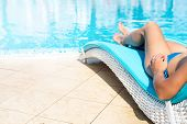 picture of legs feet  - Sexy female legs at blue water of swimming pool - JPG