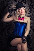 picture of cabaret  - beautiful cabaret woman posing on a chair - JPG