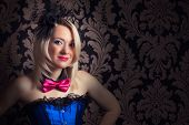 stock photo of cabaret  - beautiful cabaret woman wearing fascinator bow - JPG