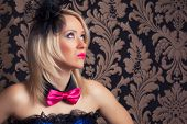 image of cabaret  - beautiful cabaret woman wearing fascinator bow - JPG