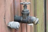 image of inlet  - Old oil inlet tap mounted on wall - JPG