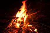 stock photo of bonfire  - Camping Bonfire with sparks at night time - JPG