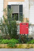 picture of postbox  - red postbox at the side of street in Italy - JPG