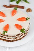 image of carrot  - Baked easter carrot cake with icing and little carrots on top on white background - JPG