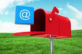 image of postbox  - Red email postbox against field and sky - JPG