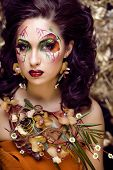 foto of fine art portrait  - beauty woman with face art and jewelry from flowers orchids close up - JPG
