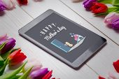 foto of wheelbarrow  - Chick with wheelbarrow of hearts against tulips on desk - JPG