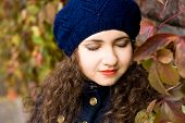 stock photo of beret  - Portrait of young beautiful brunette in blue beret - JPG