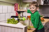 picture of juicer  - Happy toddler making green juice with a slow juicer - JPG