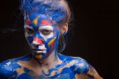stock photo of muse  - Young woman muse with creative body art and hairdo - JPG