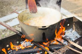 pic of cauldron  - Pilaf cooking on a fire - JPG