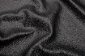 foto of blown-up  - black blown leather background texture close up - JPG