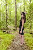 picture of little black dress  - Beautiful young sexy woman in a little black dress and high heels - JPG