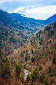 picture of smoky mountain  - Twisting and turning through a deep mountain valley - JPG