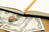 foto of memento  - Opened notebook with a blank sheet pencil and money on the old tissue - JPG