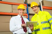 picture of warehouse  - Portrait Of Happy Warehouse Worker And Manager In A Warehouse - JPG