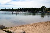 picture of raft  - The swimming area at the Zorn Park Beach, including a raft off of which swimmers may dive, in Harbor Springs, Michigan. ** Note: Soft Focus at 100%, best at smaller sizes - JPG
