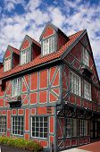 picture of gabled dormer window  - danish style building in solvang california against a cloudy sky - JPG